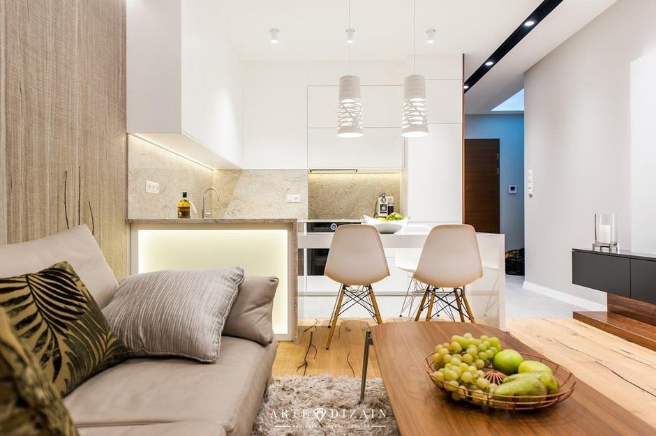 Białe Ażurowe Lampy Wiszące W Kuchni Otwartej Na Salon