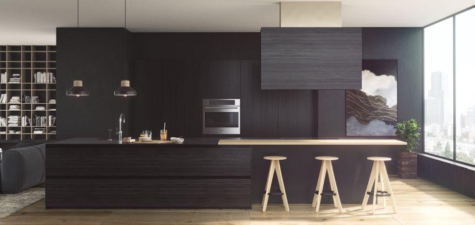 Duża wyspa kuchenna w czarnej kuchni połączonej z salonem