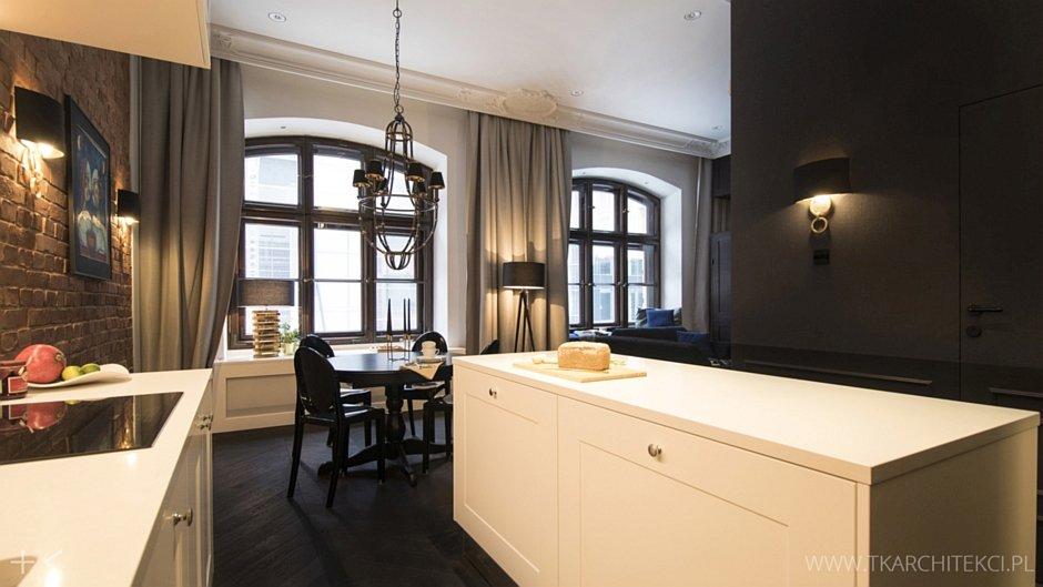 Elegancki apartament z białą wyspą
