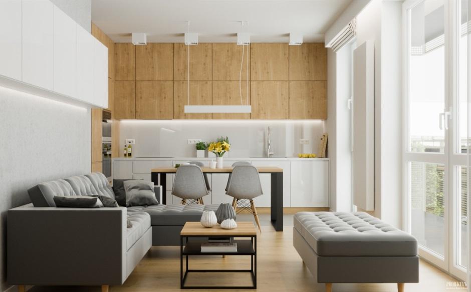 Szare meble w salonie połączonym z kuchnią i jadalnią