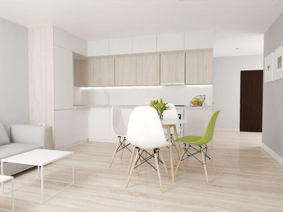 Aranżacje kuchni z kolorowymi akcentami - zielone krzesło